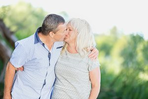 Senior marriage kissing fondly