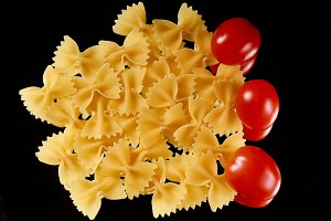 Macaroni on a black background with