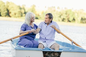 Older couple sailing on a boat.