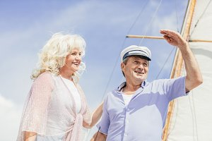 Older couple standing on a yacht