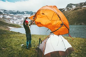 Man Traveler pitch tent camping gear