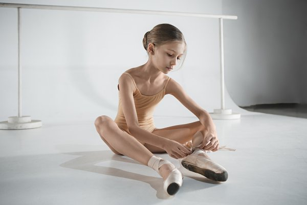 Beautiful Little Ballerina Puting On Foot Pointe Shoes High Quality People Images Creative Market