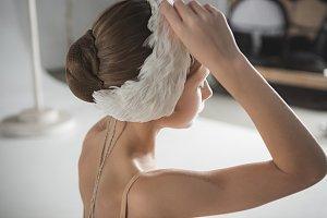 Beautiful little ballerina wearing a white swan bandage on her head
