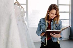 Dressmaker designing bridal wear