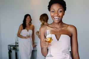 Beautiful bridesmaid having wine