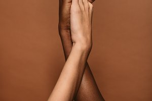 Diverse females putting hands