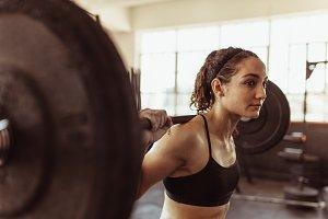 Healthy woman at gym exercising
