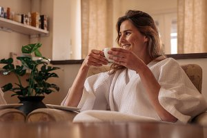 Woman having coffee and relaxing