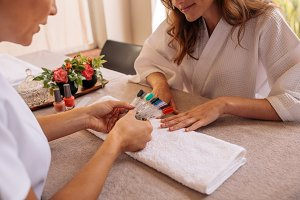Manicurist displaying samples
