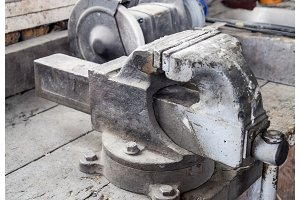 Vices on the bench. Ordinary vise. Equipment in the workshop