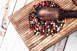 peppercorn in rustic mortar