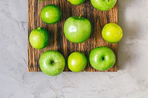 Bright green lime fruit and apples.