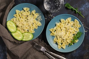 Pasta bow is sprinkled with cheese