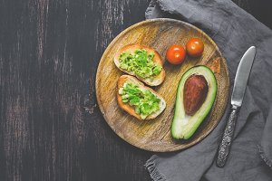 Avocado on toasted white bread, wood