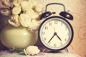 vintage retro clock and ikebana