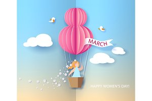 Woman in basket of hot air balloon