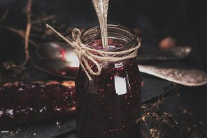 jam in a glass jar with spoon