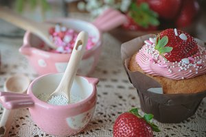 two tiny pink measuring cups