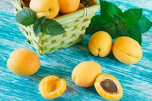 Ripe orange apricots in the basket w