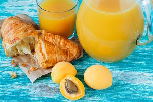 Apricot juice and croissant