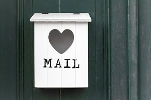 White vintage wooden mailbox