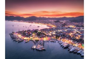 Aerial view of boats and beautiful city at night in Marmaris