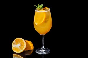 Alcoholic orange juice on a black background.