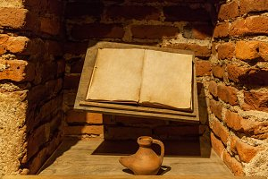 Ancient book with an inkwell.
