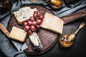 Cheese on rustic wooden plate