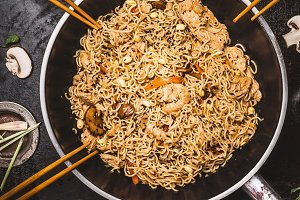 Fried noodles in wok pan