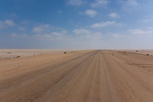 Road between desert and ocean