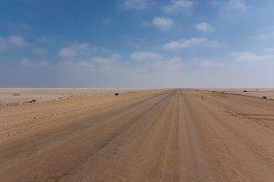 Road between desert and ocean