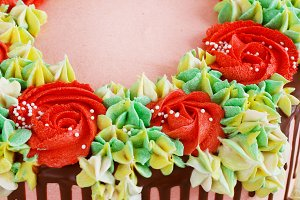 Birthday cake with flowers rose on w