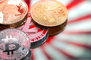 coins litecoin and Bitcoin, against the backdrop of Japan and the Japanese flag, the concept of virtual money, close-up.