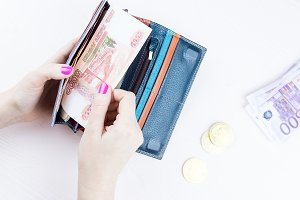purse with money and bitcoin