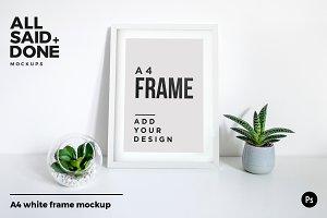 A4 white portrait frame on desk