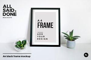 A4 black portrait frame on desk