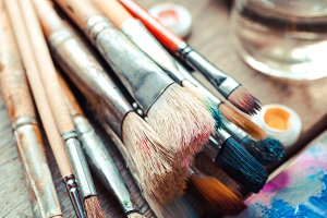 Paintbrushes, palette and paints
