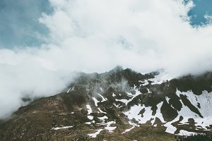 Rocky mountains and clouds Landscape