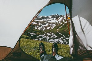 Feet Man relaxing enjoying mountains
