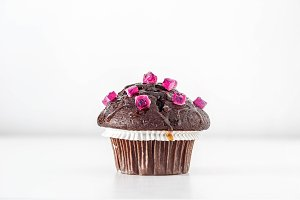 Chocolate Muffin with pink candies