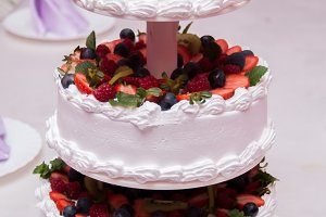 Wedding cake decorated with flowers and berries