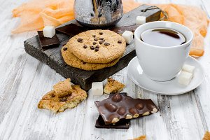 Cup tea, biscuits on white wooden