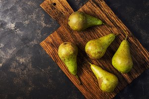 Ripe green pear on a dark background