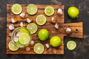 Cooling drink with lime. Sliced lime