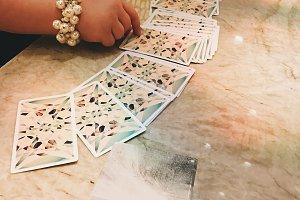 Woman's Hands Dealing Tarot Deck