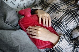 Woman having painful period cramps