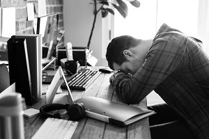 Man napping on the working desk