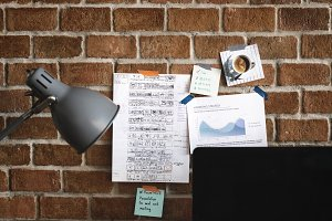 Workspace with note on brick wall
