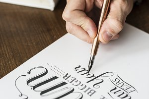 Closeup of a calligrapher working